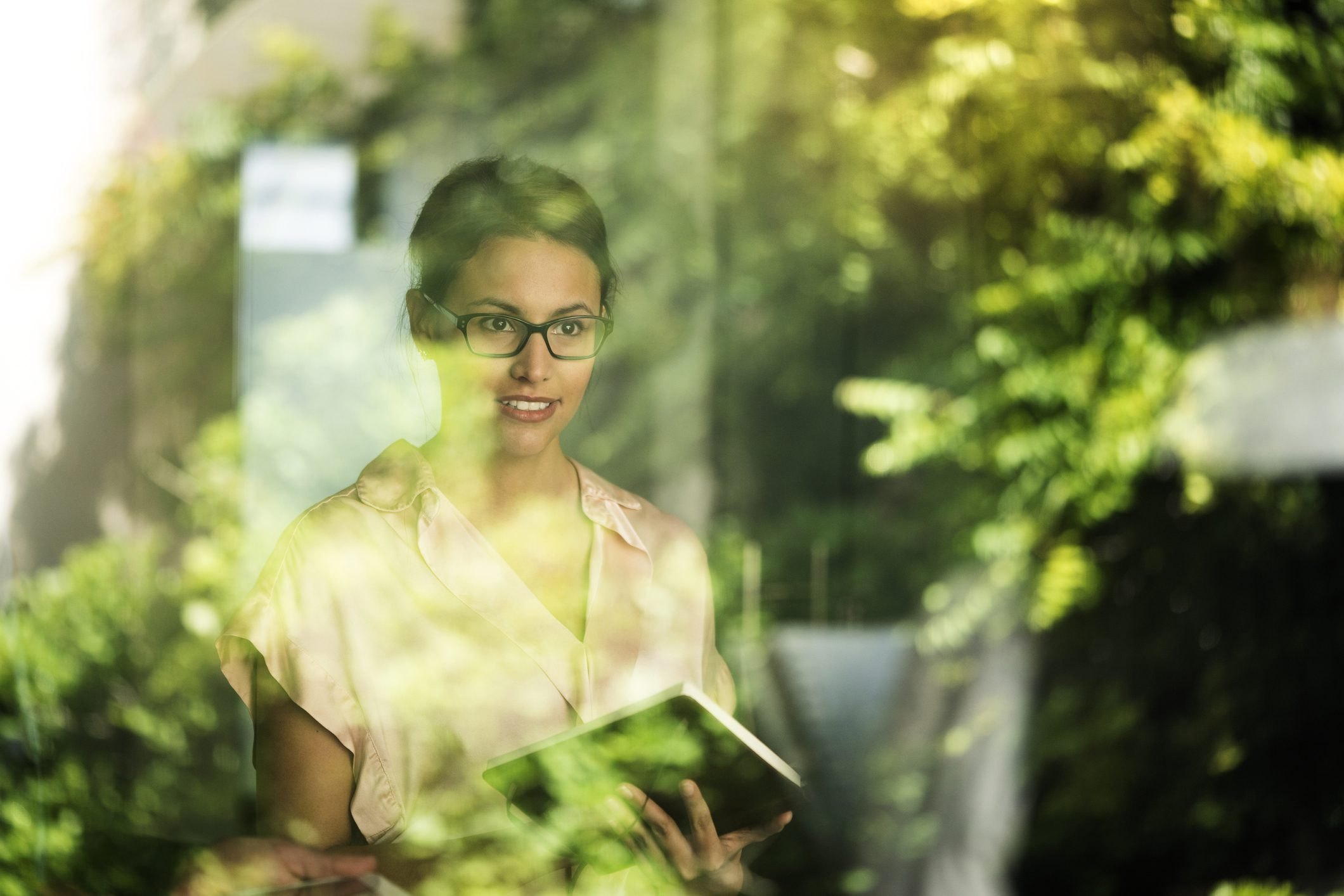 Business women wearing glasses with a diary