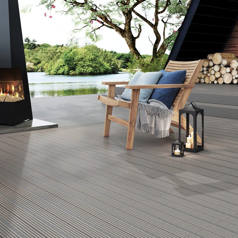 Grey composite decking with garden chair