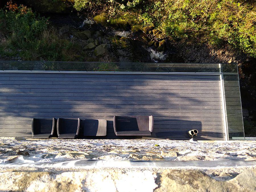 grey decking with garden chairs
