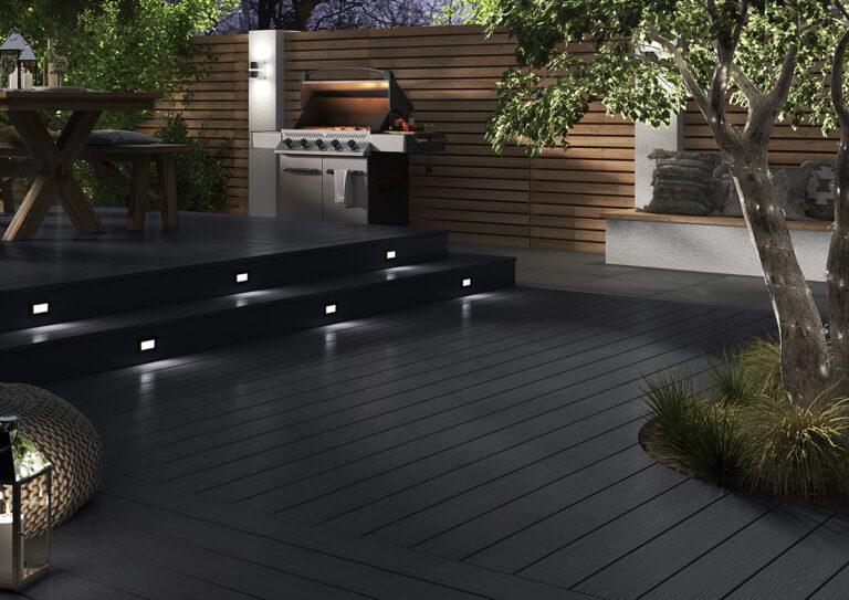 Black composite decking landscape with step lights